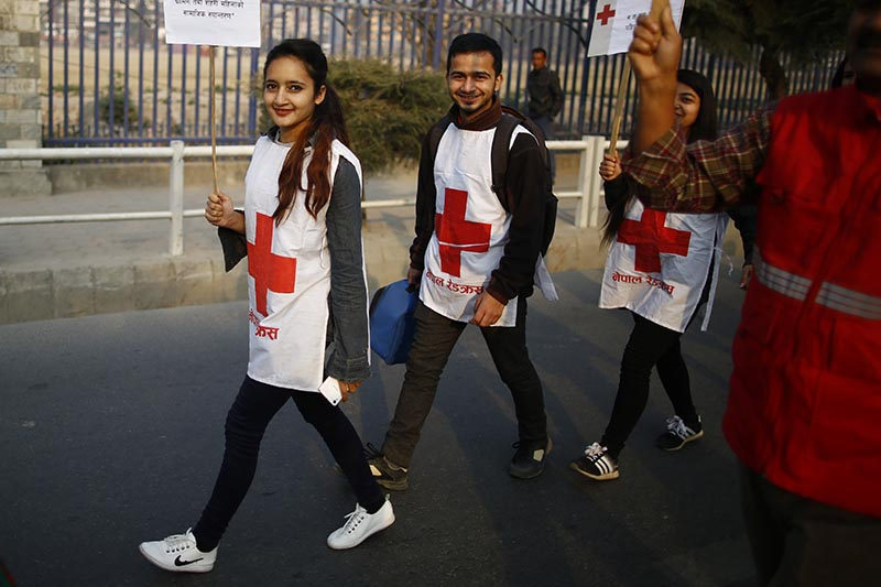 Youths of Nepal Red Cross Society march in a rally held to mark the 108th International Women's Day organised by the Ministry of Women, Children and Social Welfare in Kathmandu, on Thursday, March 8, 2018. Photo: Skanda Gautam/THT