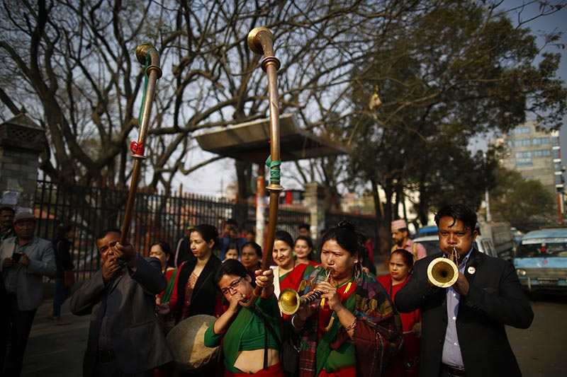 People play traditional instruments  in a rally held to mark the 108th International Women's Day organised by the Ministry of Women, Children and Social Welfare in Kathmandu, on Thursday, March 8, 2018. Photo: Skanda Gautam/THT