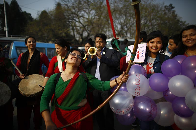 A woman dances while participating in a rally held to mark the 108th International Women's Day organised by the Ministry of Women, Children and Social Welfare in Kathmandu, on Thursday, March 8, 2018. Photo: Skanda Gautam/THT