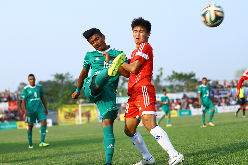 Players of TAC and NPC (right) vie for the ball during their third Rumpum Jhapa Gold Cup match in Birtamod on Thursday. Photo: THT