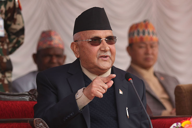 Prime Minster KP Sharma Oli speaks at a tea party organised in honour of HoR, National Assembly, State Assembly members supporting Oli-led government, at Baluwater, Kathmandu, on Wednesday, March 14, 2018. Photo: RSS