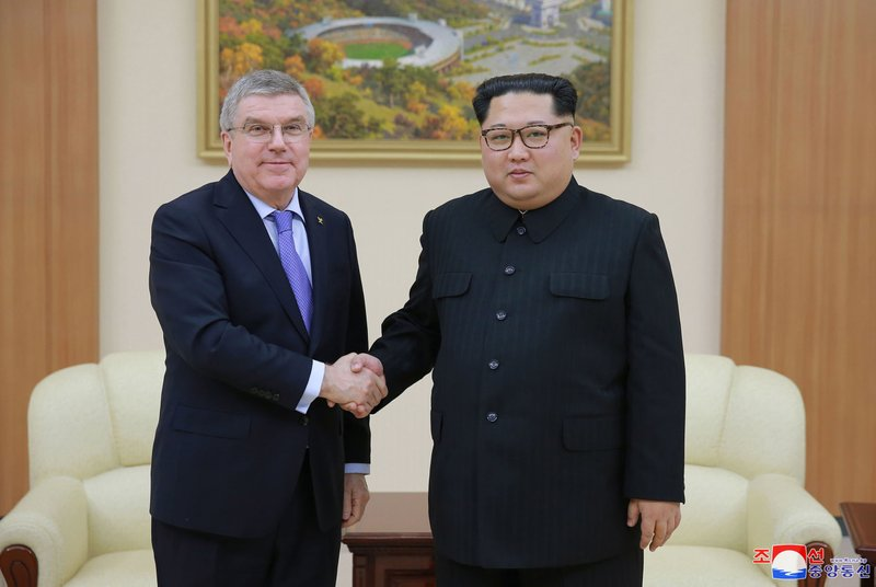 In this photo provided by the North Korean government on Saturday, March 31, 2018, North Korean leader Kim Jong Un, right, poses with International Olympic Committee President Thomas Bach for a photo during a meeting in Pyongyang, North Korea. Photo: AP