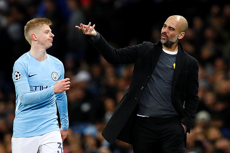 Manchester City manager Pep Guardiola with Oleksandr Zinchenko during the Champions League, round of 16, second leg soccer match between Manchester City and Basel at the Etihad Stadium in Manchester, England, Wednesday, March 7, 2018. Photo: Reuters