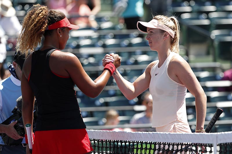 Elina Svitolina of Ukraine (right) shakes hands with Naomi Osaka of Japan (left) after their match on day four of the Miami Open at Tennis Center at Crandon Parkm in Key Biscayne, Florida, USA on March 23, 2018. Photo: Geoff Burke-USA TODAY Sports via Reuters
