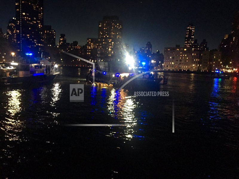 This image made from video provided by the New York City Police Department shows the scene of a helicopter crash in the East River in New York on Sunday, March 11, 2018.  Photo: New York City Police Department via AP