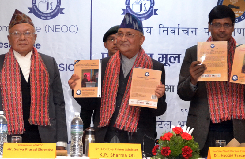 PM unveiling the final report of Election Observation Mission at a programme organised by National Election Observation Commission in  Kathmandu on Sunday, March 25, 2018. Photo: RSS