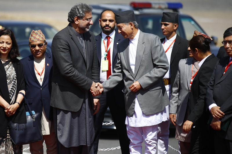 Pakistani Prime Minister Shahid Khaqan Abbasi shakes hand with Finance Minister Yubaraj Khatiwada before his departure at Tribhuvan International Airport in Kathmandu, on Tuesday, March 6, 2018. Photo: Skanda Gautam