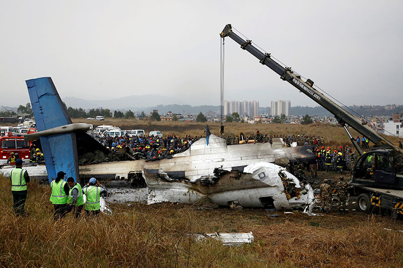 Rescue workers operate at the wreckage of the US-Bangla airplane after it crashed at Tribhuvan International Airport, in Kathmandu, Nepal, on Monday, March 12, 2018. Photo: Reuters