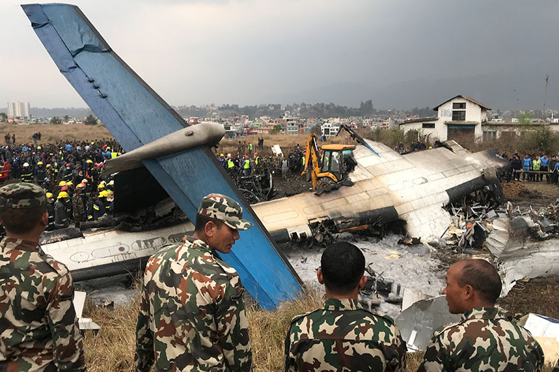 Wreckage of the US-Bangla aircraft is pictured as rescue workers operate at Tribhuvan International Airport, in Kathmandu, on Monday, March 12, 2018. Photo: Reuters