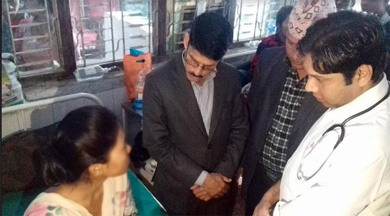 Chief Minister of Province 7 Trilochan Bhatta visits Radha Chaudhary at Seti Zonal Hospital in Dhangadhi, on Sunday, March 11, 2018. Photo: Tekendra Deuba