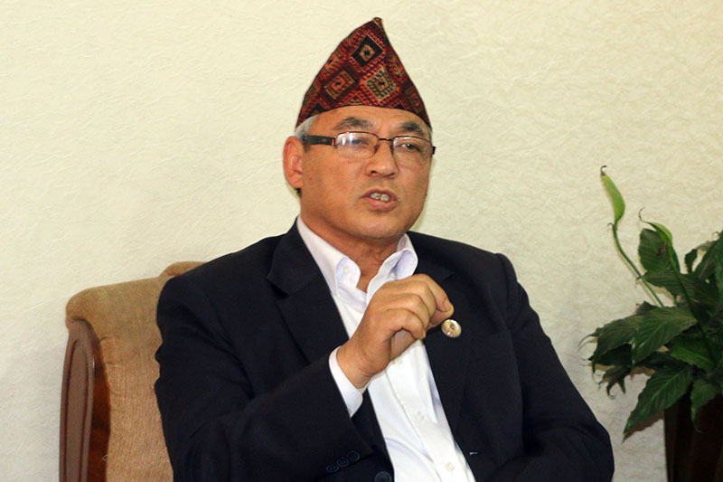 Minister for Home Affairs Ram Bahadur Thapa speaking to media at the ministry in Kathmandu, on Sunday, March 11, 2018. Photo: RSS