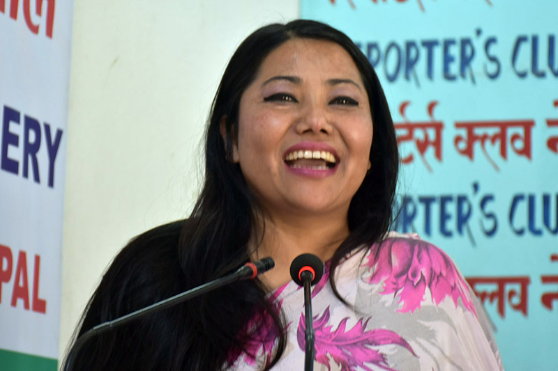 UML lawmaker Ram Kumari Jhakri speaks on the occasion of 108th International Women's Day in Kathmandu, on Thursday, March 08, 2018. Courtesy: Reporters Club
