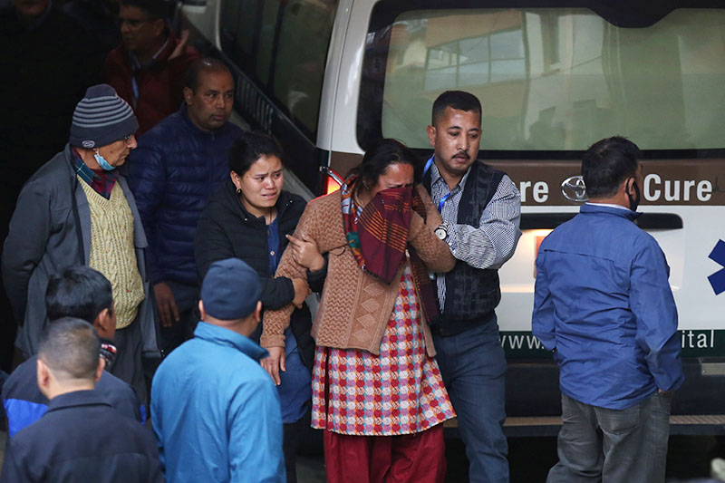 Family member of a victim mourns outside a hospital after the US-Bangla airplane crashed while arriving from Dhaka, in Kathmandu, Nepal, on Monday, March 12, 2018. Photo: Reuters