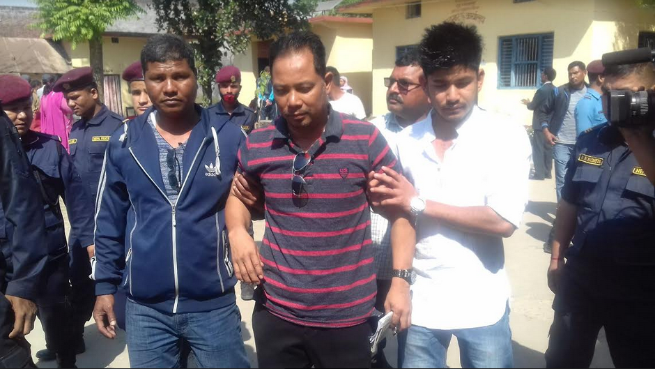 Alleged Tikapur Carnage conspirator Resham Chaudhary being taken outside the District Prison, Kailali on Saturday, March 10, 2018. Photo: Tekendra Deuba