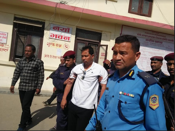 Police taking Resham Chaudhary to Seti Zonal Hospital for diagnosis. Photo: Tekendra Deuba