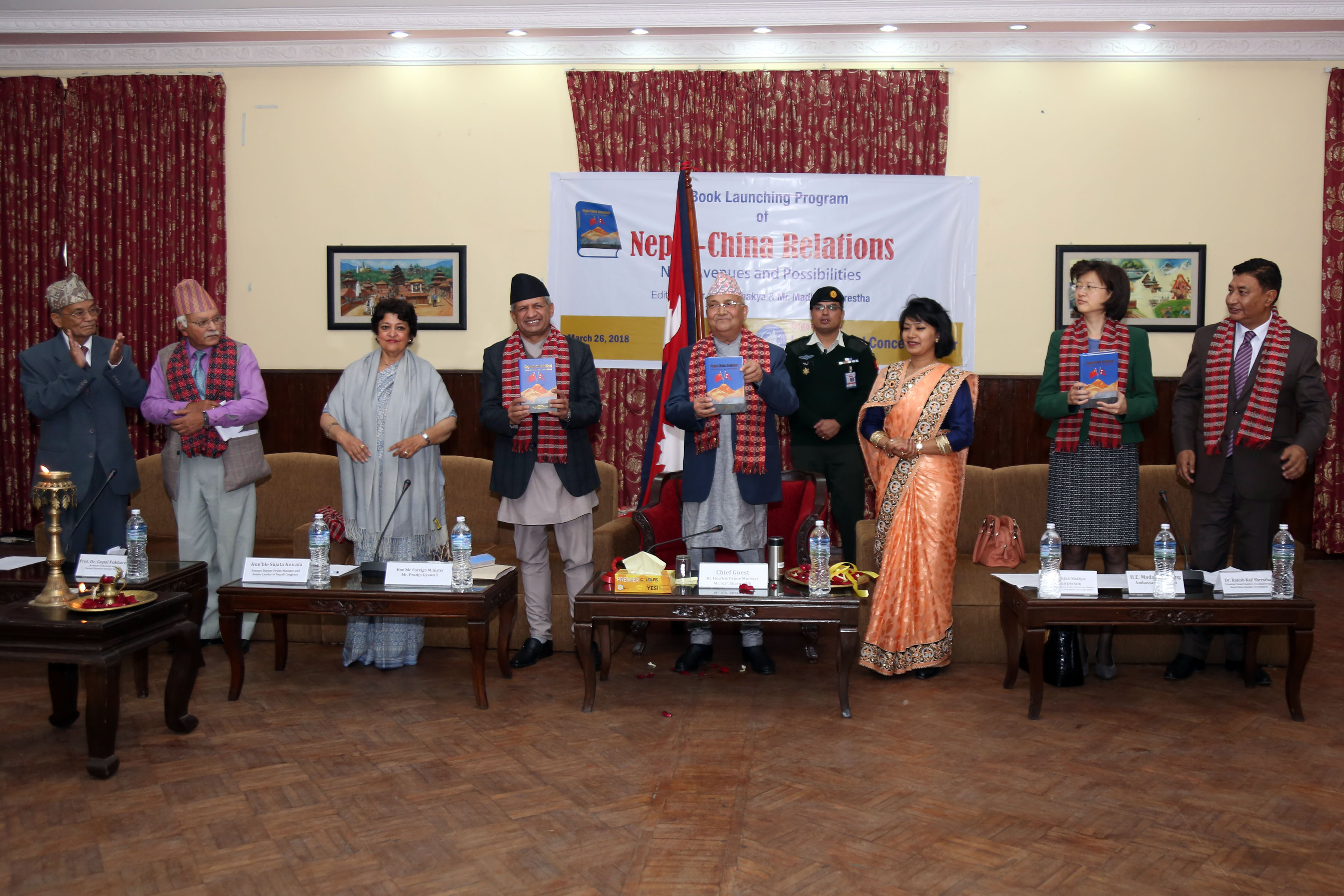 Prime Minister KP Oli, Foreign Minister Pradeep Kumar Gyawali release a book on 'Nepal-China relations' amid a function held at the Prime Minister's official residence in Baluwatar on Monday, March 26, 2018.