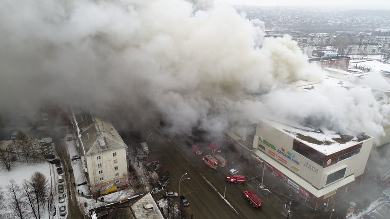 File - In this Russian Emergency Situations Ministry photo, smoke rises above a multi-story shopping center in the Siberian city of Kemerovo, about 3,000 kilometers (1,900 miles) east of Moscow, Russia,  on Sunday, March 25, 2018. Photo: AP