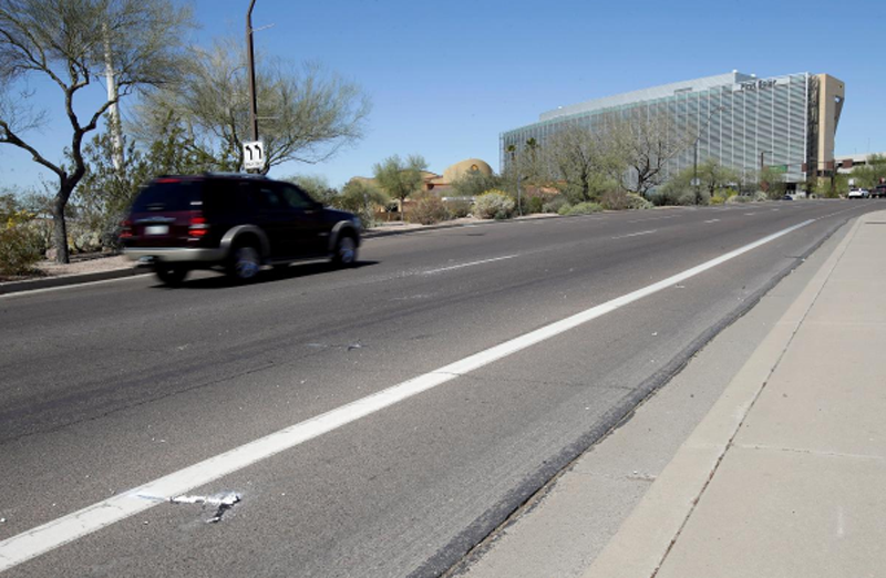 Burned out flares lie at the location where a woman pedestrian was struck and killed by an Uber self-driving sport utility vehicle in Tempe, Arizona, US, March 19, 2018. Photo: Reuters