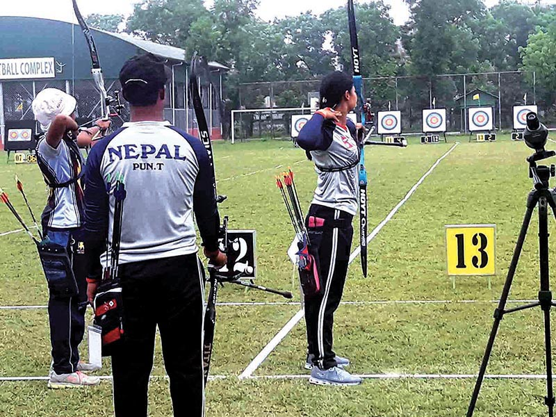 Nepali archers in action during the third South Asian Archery Championship in Dhaka on Monday. Photo Courtesy: NSJF