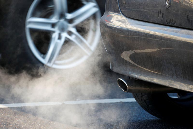 FILE PHOTO: An exhaust pipe of a car is pictured on a street in a Berlin, Germany, February 22, 2018. Photo: Reuters