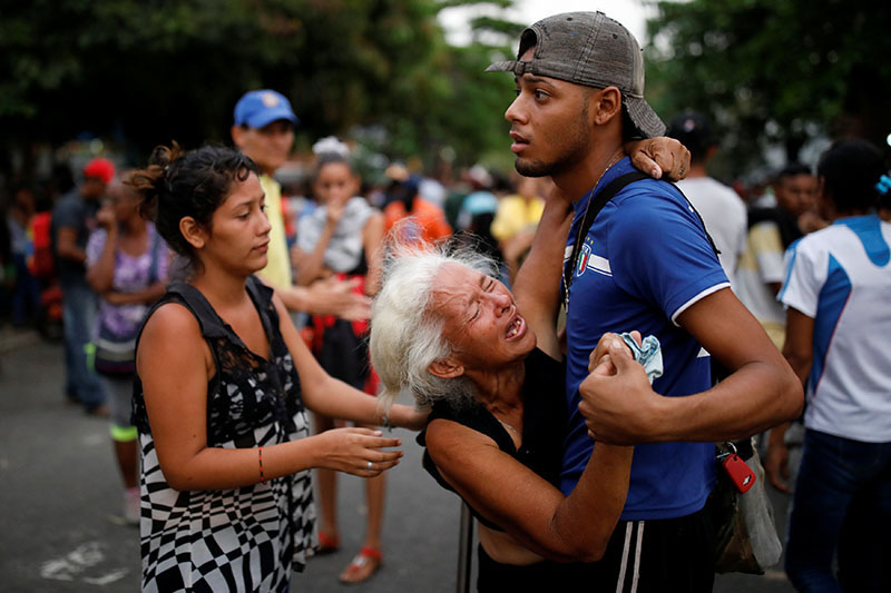 Relatives of inmates held at the General Command of the Carabobo Police react as they wait outside the prison, where a fire occurred in the cells area, according to local media, in Valencia, Venezuela, on March 28, 2018. Photo: Reuters