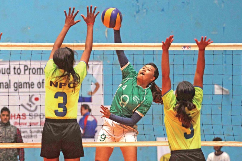 Manju Gurung (center) of New Diamond Academy attempts for spike against Nepal Plice Club players in semi-final match during NST-NVA Club Volleyball Tournament at NSC Covered Hall, Tripureshwor in Kathmandu on Friday, March 2,2018. Photo: Udipt Singh Chhetry/THT
