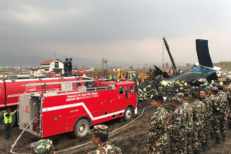 Wreckage of the airplane is pictured as rescue workers operate at Tribhuvan International Airport in Kathmandu, on Monday, March 12, 2018. Photo: Reuters