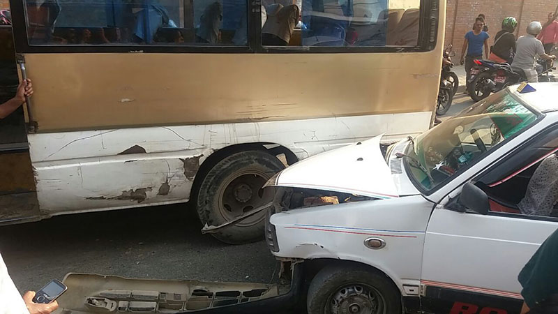 A taxi rams into a Nepal Yatayat bus on the main road in Anamnagar, Kathmandu, on Tuesday, April 24, 2018. Damages were incurred on both the vehicles, however, all passengers were reported safe. Photo: Monica Lohani/THT