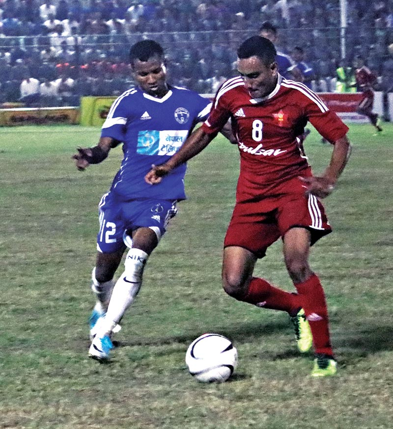 Players of NPC and TAC (right) vie for the ball during their Birat Gold Cup match at the Shahid Maidan in Biratnagar on Wednesday. Photo: THT