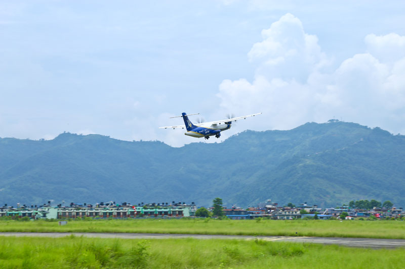 An aircraft of Buddha Air is seen flying, in this undated photo. Courtesy: Buddha Air