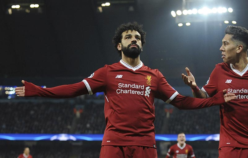 Liverpool's Mohamed Salah (left), celebrates scoring his side's first goal with Liverpool's Roberto Firmino during the Champions League quarterfinal second leg soccer match between Manchester City and Liverpool at Etihad stadium in Manchester, England, on Tuesday, April 10, 2018. Photo: AP