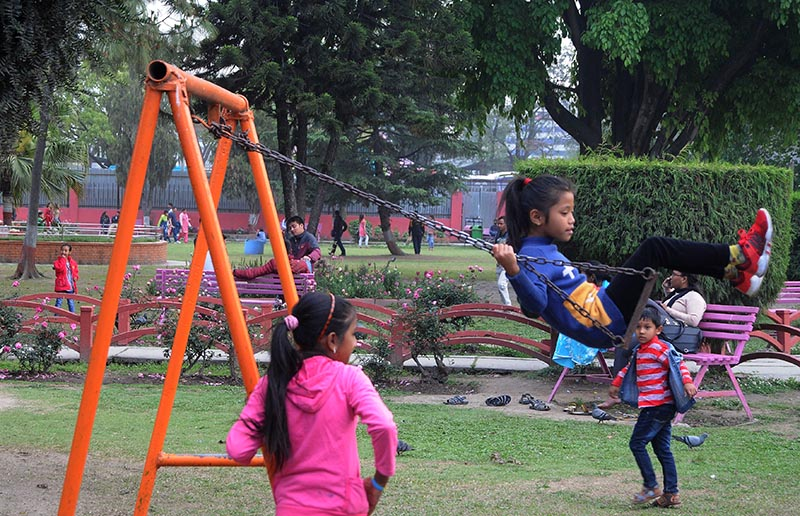 A girl enjoying on a swing at an amusement park, in Kathmandu, on Saturday. Photo: THT