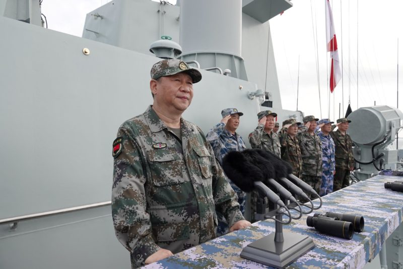 Chinese President Xi Jinping delivers a speech as he reviews a military display of Chinese People's Liberation Army (PLA) Navy in the South China Sea