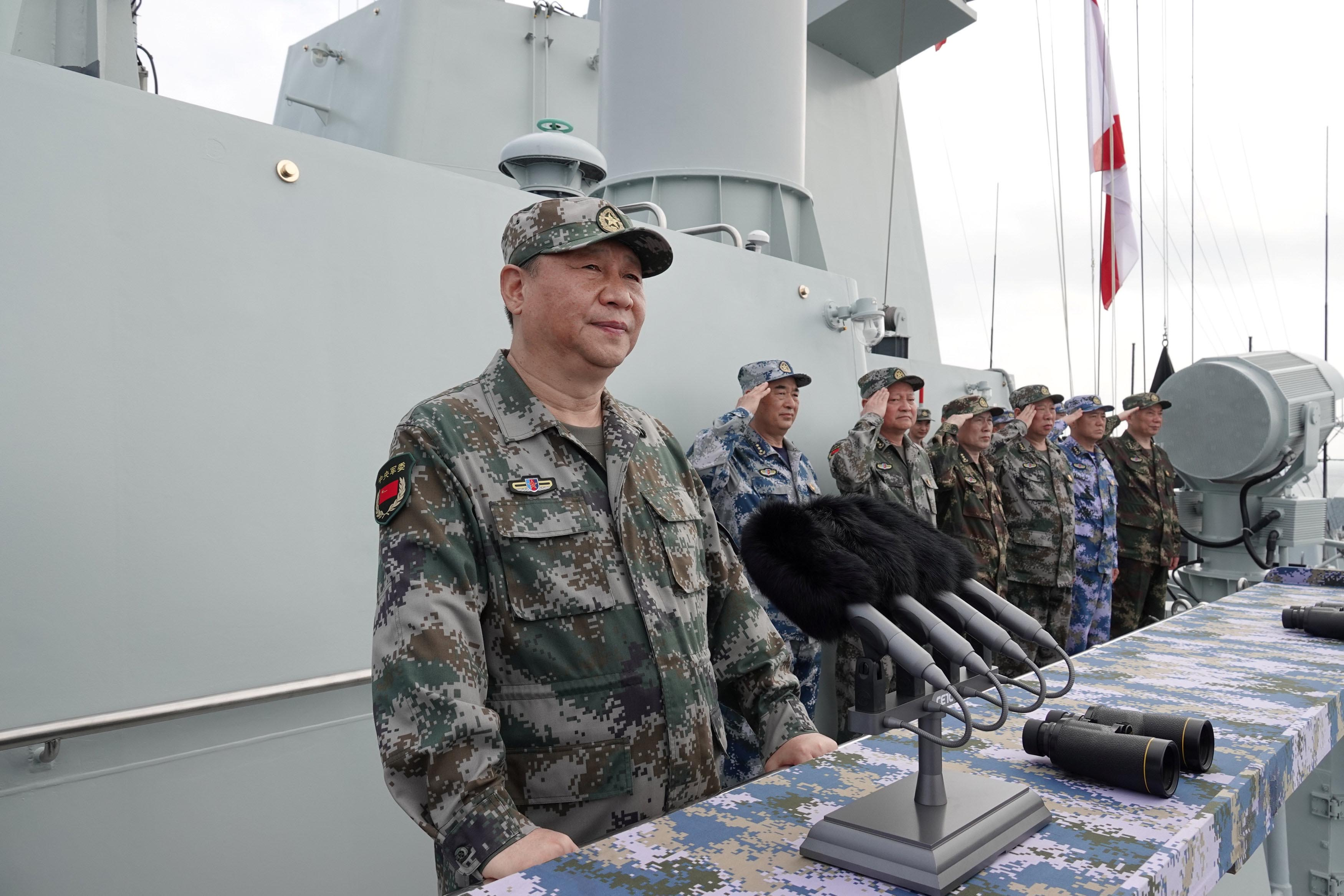 Chinese President Xi Jinping delivers a speech as he reviews a military display of Chinese People's Liberation Army (PLA) Navy in the South China Sea April 12, 2018. Photo: Li Gang/Xinhua via Reuters