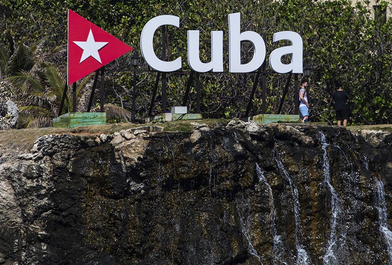 Tourists walk in the gardens beside the waterfall of the Nacional Hotel in Havana, Cuba, Wednesday, April 18, 2018. Photo: AP