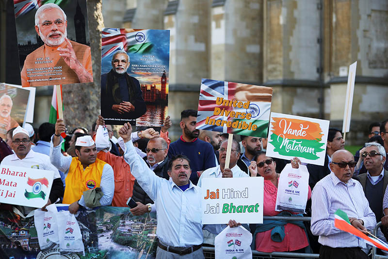 Demonstrator holds a placards and pictures of India's Prime Minister Narendra Modi in Parliament Square, London, Britain, April 18, 2018. Photo: Reuters