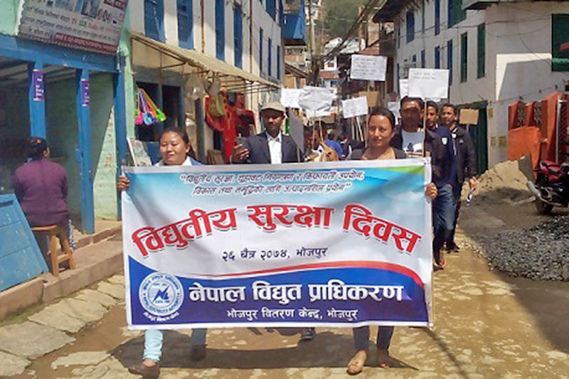 Locals taking part in a rally organised by the Nepal Electricity Authority Bhojpur Distribution Centre on the occasion of Electricity Safety Day in the district, on Monday, April 09, 2018. Photo: Niroj Koirala