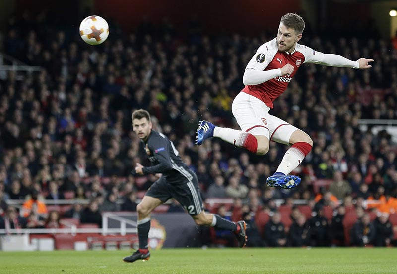 CSKA's Georgi Schenniko (left), looks om as Arsenal's Aaron Ramsey, right, scores his sides third goal during the Europa League quarterfinal, first leg soccer match between Arsenal and CSKA Moscow at the Emirates stadium in London, on Thursday, April 5, 2018. Photo: AP