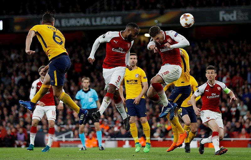 Arsenal's Alexandre Lacazette and Aaron Ramsey in action during the Europa League semi-final first leg match between Arsenal and Atletico Madrid, at Emirates Stadium, in London, Britain, on Aril 26, 2018. Photo: Action Images via Reuters