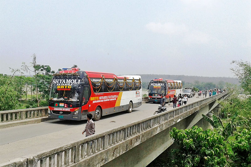 After an agreement to operate bus service in four countries---India, Nepal, Bhutan and Bangladesh---two buses on trial departed from Dhaka of Bangladesh have arrived in Kakirbhitta, Nepal, on Wednesday, April 25, 2018. Photo: RSS