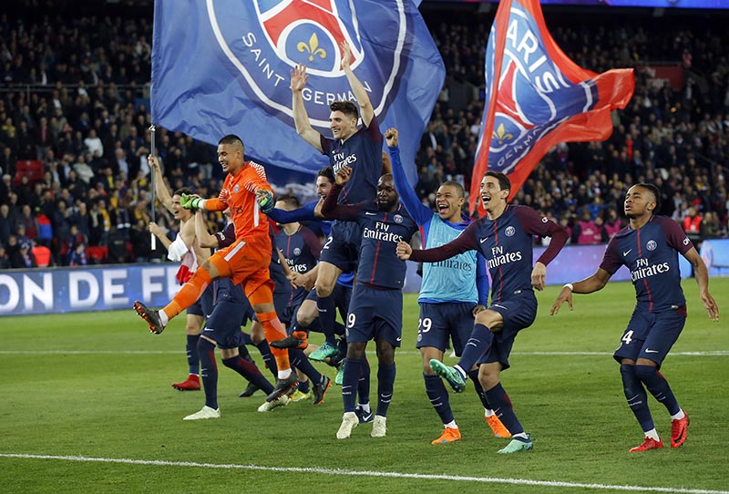 FILE - nPSG players celebrate at the end of the French League One soccer match between Paris Saint Germain and Monaco at the Parc des Princes stadium in Paris, on Sunday, April 15, 2018. Photo: AP