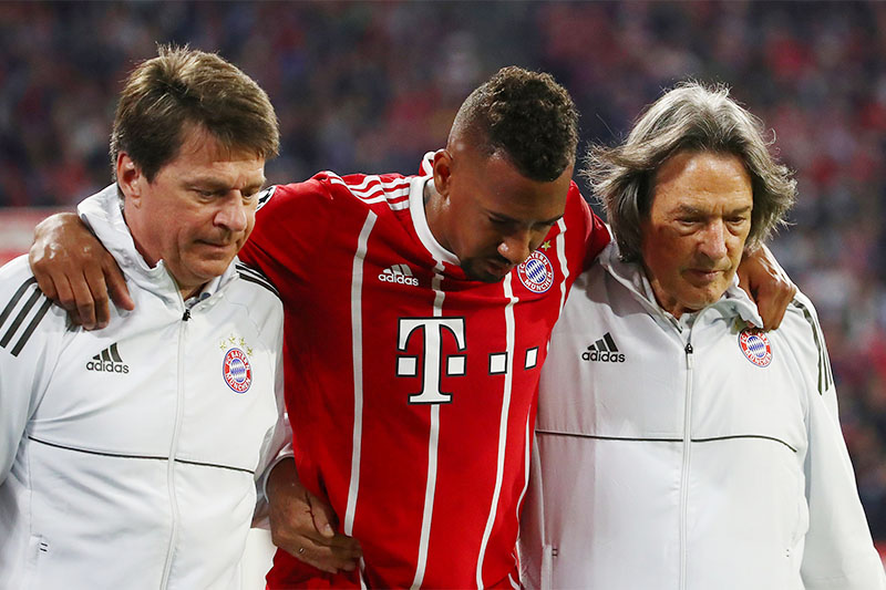 Bayern Munich's Jerome Boateng leaves the pitch with medical staff after sustaining an injury. Photo: Reuters