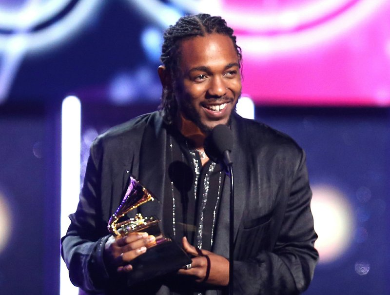 File - In this photo, rapper Kendrick Lamar accepts the award for best rap album for u201cDamnu201d at the 60th annual Grammy Awards in New York on  Jan. 28, 2018. Photo: AP