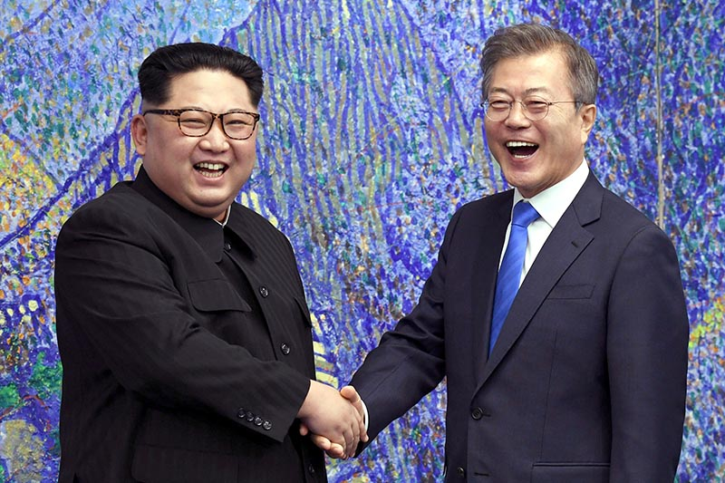 North Korean leader Kim Jong Un (left) poses with South Korean President Moon Jae-in for a photo inside the Peace House at the border village of Panmunjom in Demilitarized Zone, on Friday, April 27, 2018. Their discussions will be expected to focus on whether the North can be persuaded to give up its nuclear bombs. Photo: Korea Summit Press Pool via AP