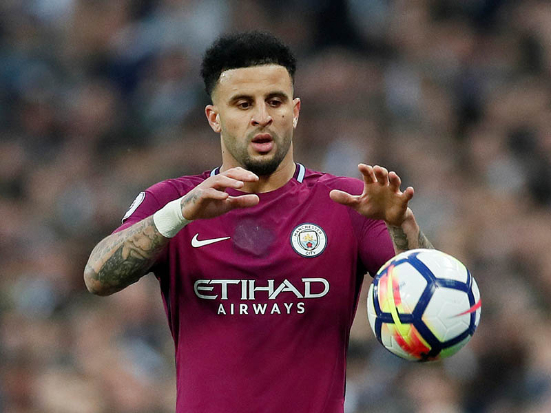 Manchester City's Kyle Walker prepares to take a throw-in. Photo: Reuters