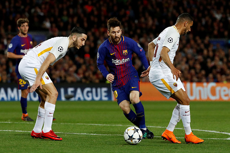 Barcelona's Lionel Messi in action with Roma's Bruno Peres. Photo: Reuters