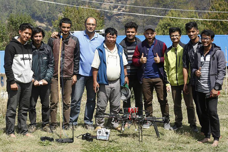 A team of Nepali engineers pose for a picture along with the medical drone used to supply medicines in remote villages in Myagdi, Nepal April 9, 2018. Photo courtesy: Kamal Pun