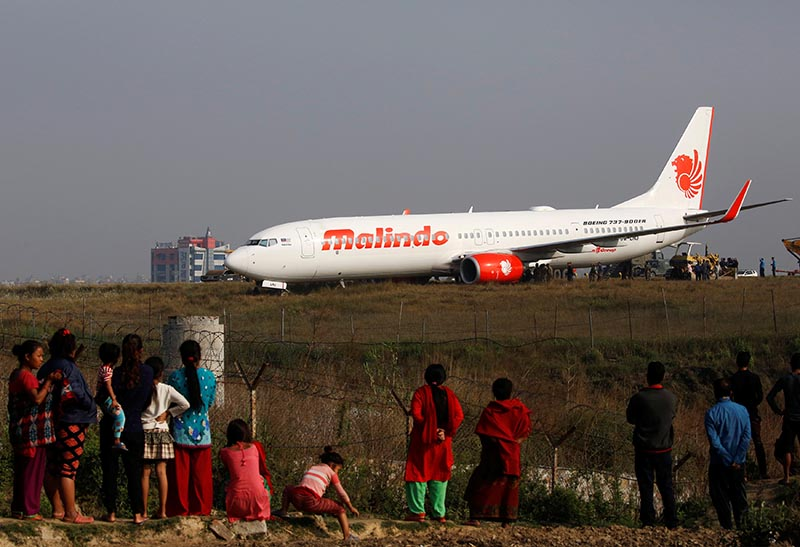 People look at an aircraft belonging to Malindo Air that slid off the runway during take-off last night at Tribhuvan International Airport in Kathmandu, on Thursday, April 20, 2018. Photo: Navesh Chitrakar