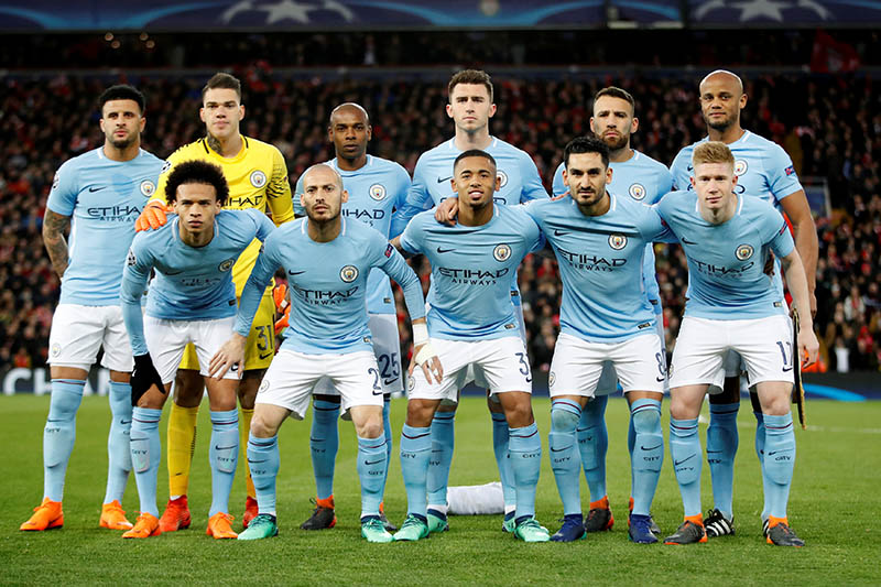 Manchester City players pose for a team group photo before the match. Photo: Reuters