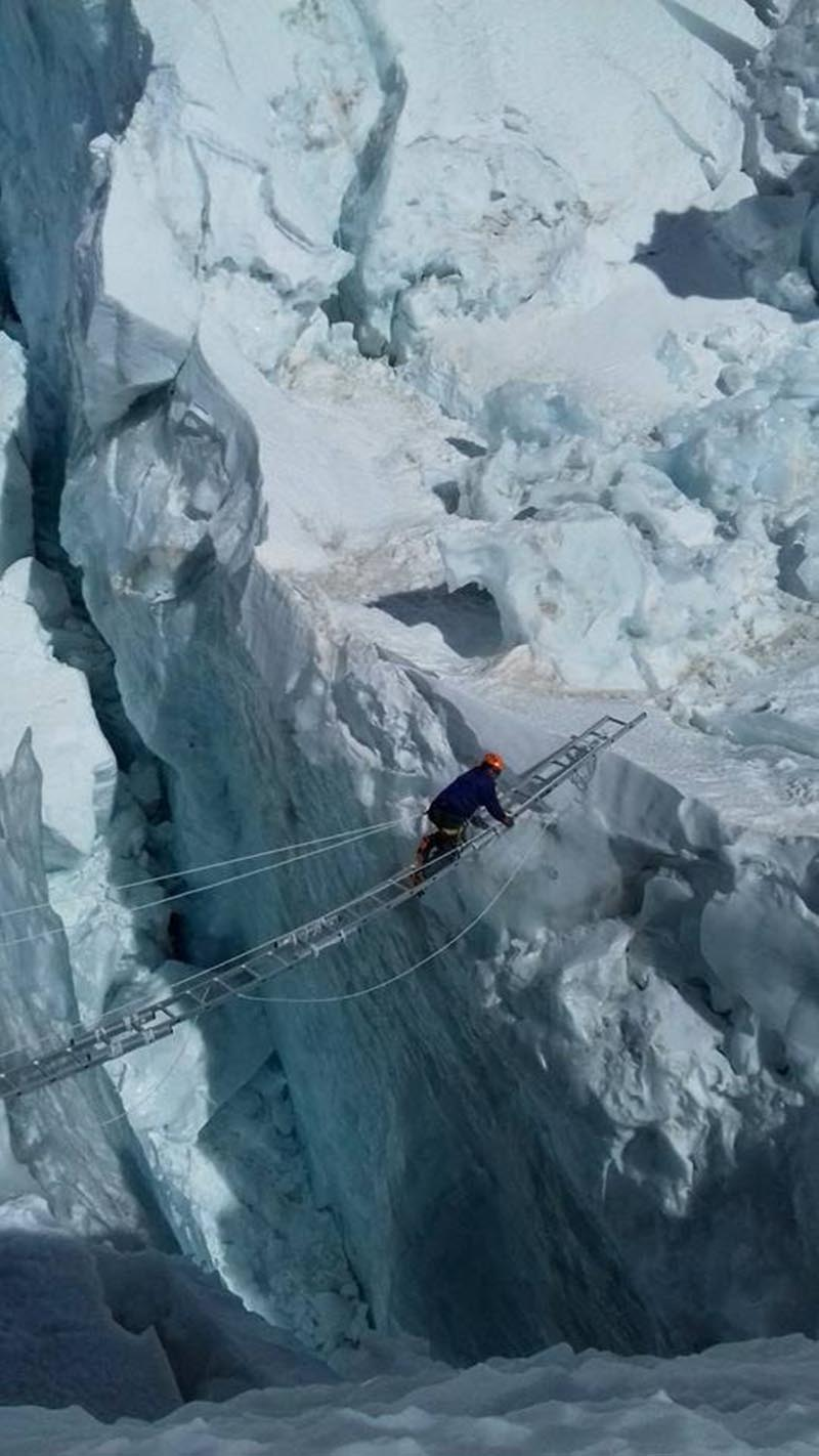 FILE: An icefall doctor placing aluminium ladders and black diamond static ropes while preparing a climbing route along the treacherous section above the Base Camp on the way to Mt Everest for spring climbing. Photo courtesy: Nishan Shrestha / SPCC